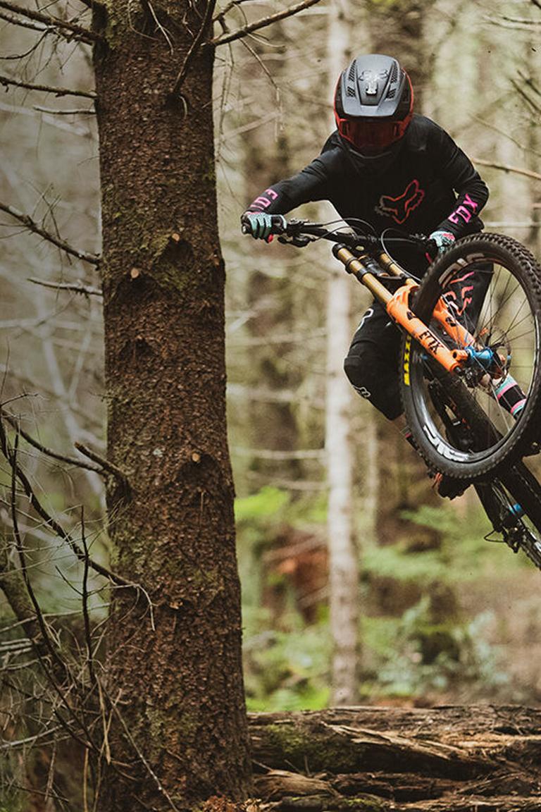 Fox Rider Jackson Goldstone Jumping off a Log on his Mountain Bike