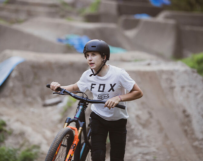 Jackson Goldstone hits the dirt jumps in a Fox Legacy tee shirt, keeping him cool and dry on his ride